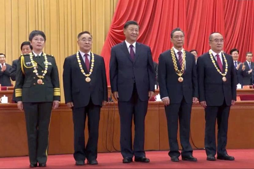 China honors people fighting COVID-19 with national medals.